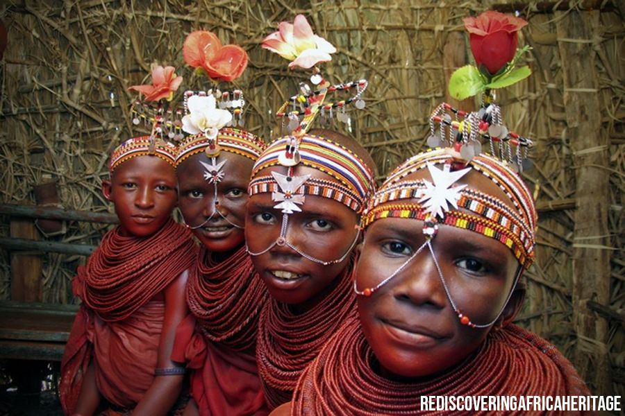 Embu Tribe's young members with red body paint and head and face colorful embellishments as traditional outfit | Flash mctours and Travel