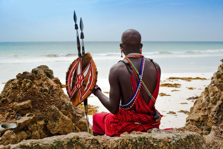 A member of Kenyan tribe in front of the beach